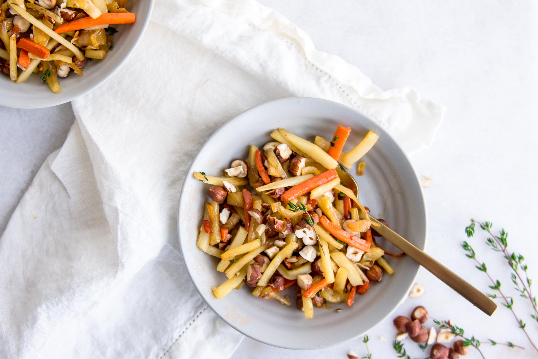 maple-glazed root vegetables with hazelnuts in bowls