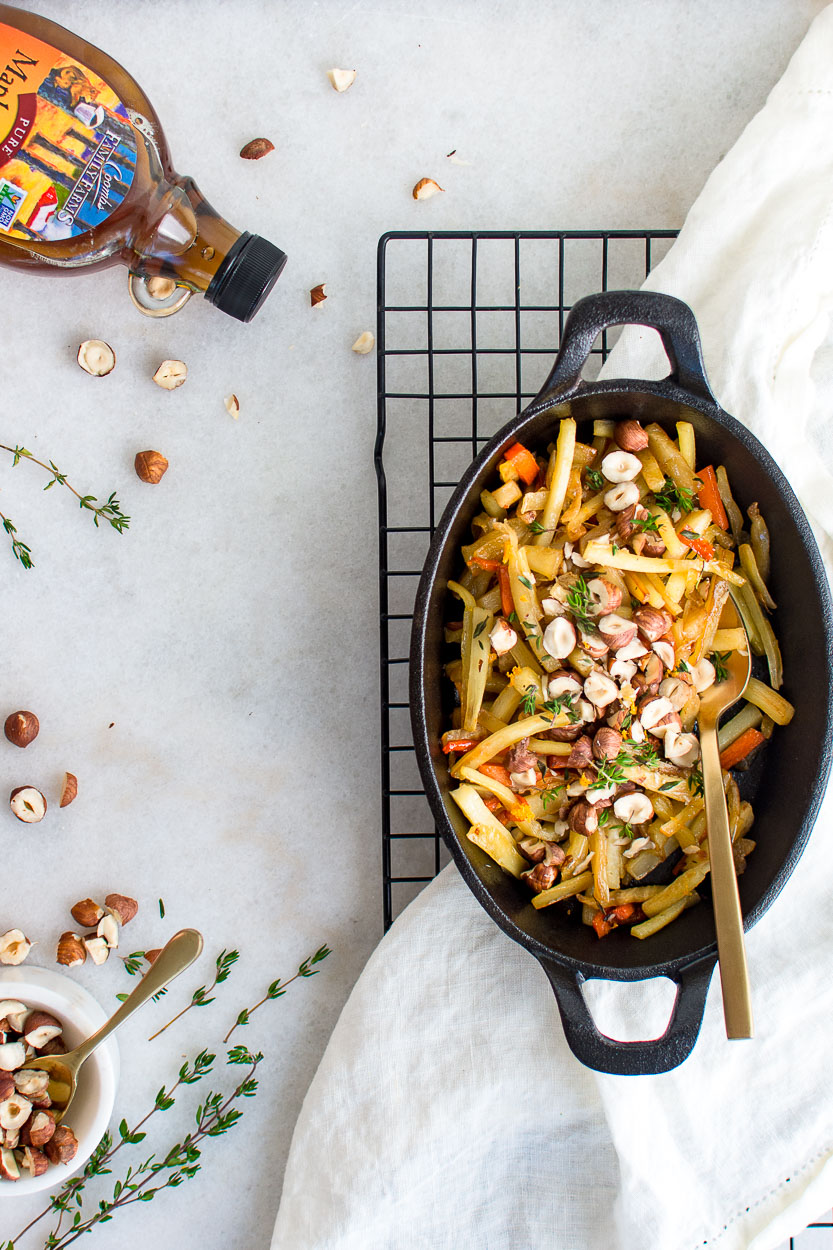 Maple Glazed Root Vegetables topped with hazelnut and thyme.