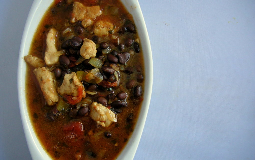 black bean soup warm spicy brimming with chicken beans and vegetables ...