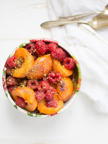 Melted Apricots with Fresh Raspberries and Pistachio Dust. It's an easy, no-sugar dessert recipe that's perfect for early summer.