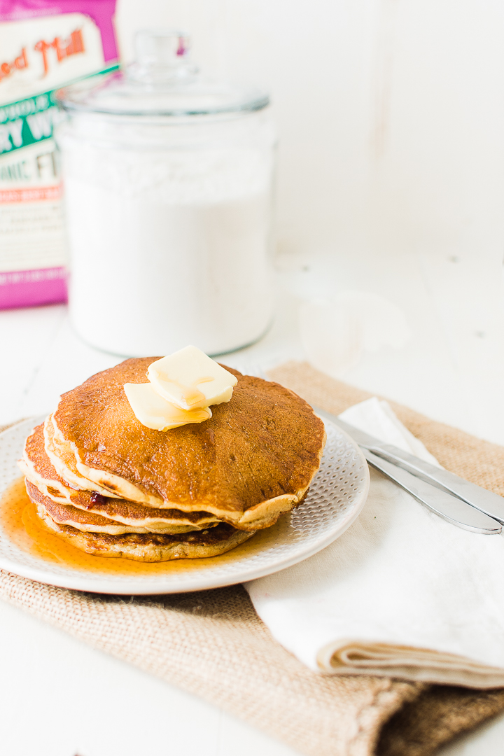 Whole grain sourdough pancakes served with maple syrup.