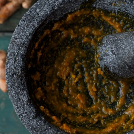 Making Golden Tea: Turmeric, Ginger and Honey in a Molcajete