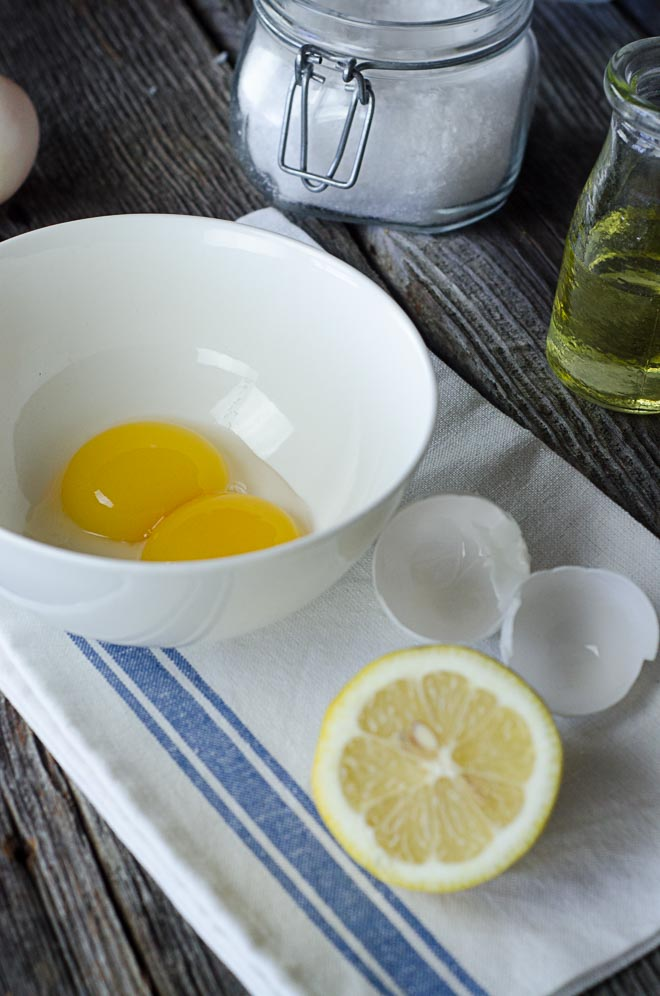 Egg yolks, lemon, salt and avocado oil for homemade avocado oil mayonnaise. #nourishedkitchen