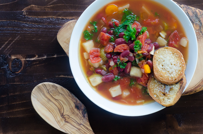 Super easy (and budget-friendly!) Bean and Vegetable Soup for the InstantPot. Made with kidney beans, carrots, onions, celery, garlic, kale and tomatoes.