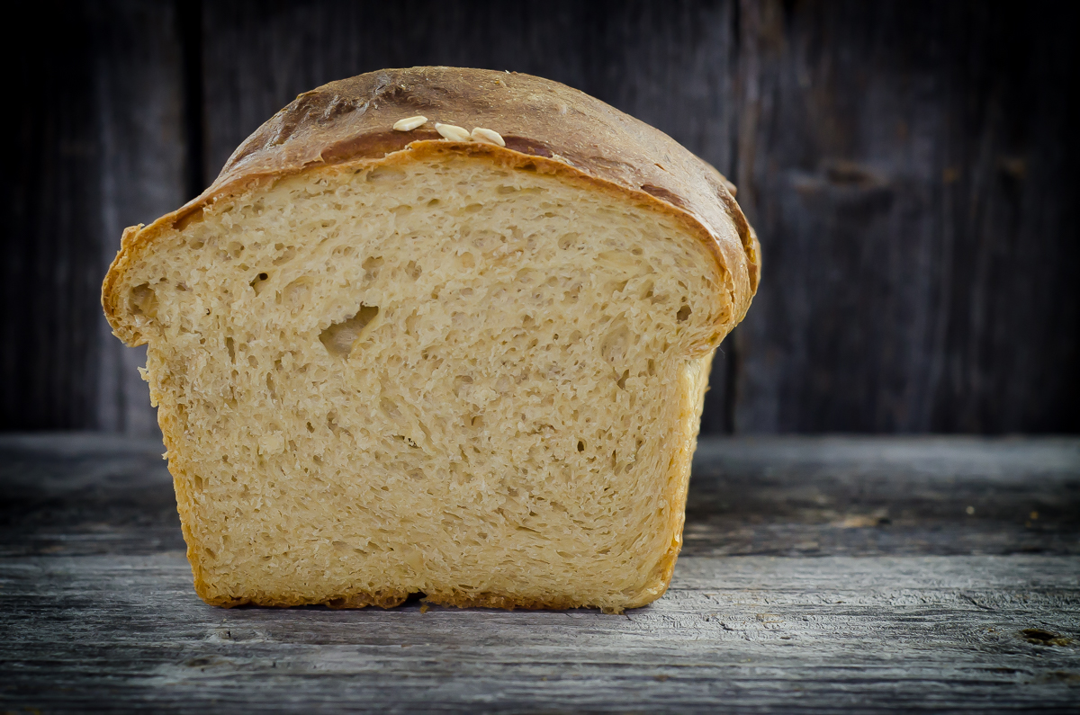 Milk and Honey Sandwich Bread made with Identity-Preserved Whole White Wheat Flour, Oats, Milk, Honey and yeast. It's super easy, with a great crumb and crust.