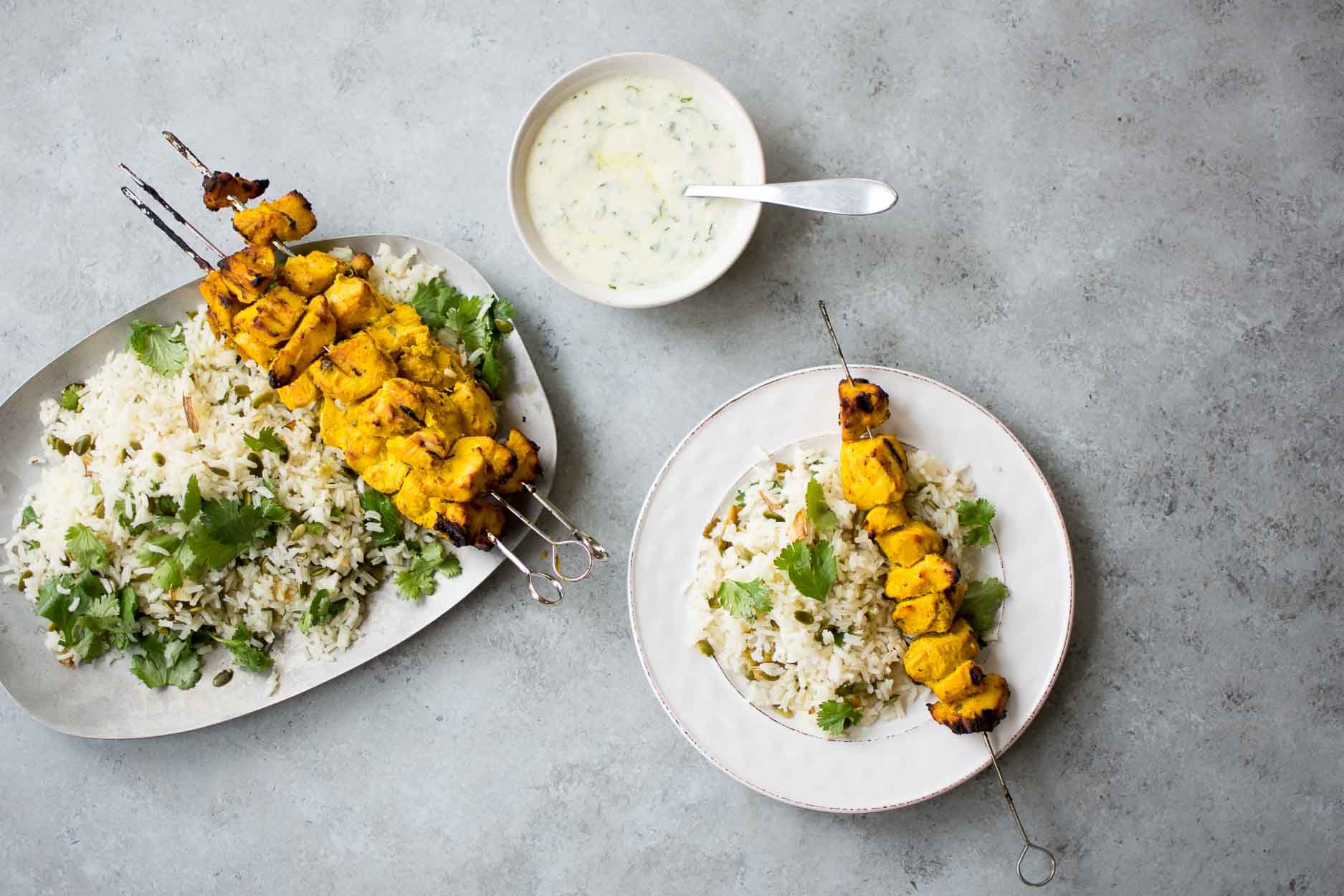 Grilled Turmeric Chicken Kebabs over Basmati Rice with Charred Scallions makes a super easy weeknight supper.