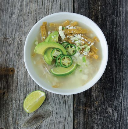 Traditional Yucatan Lime Soup: Chicken is slowly simmered to make a fine, light broth. Add rice to the bowl and garnish with corn tortillas, avocado, lime, cilantro and cotija cheese.
