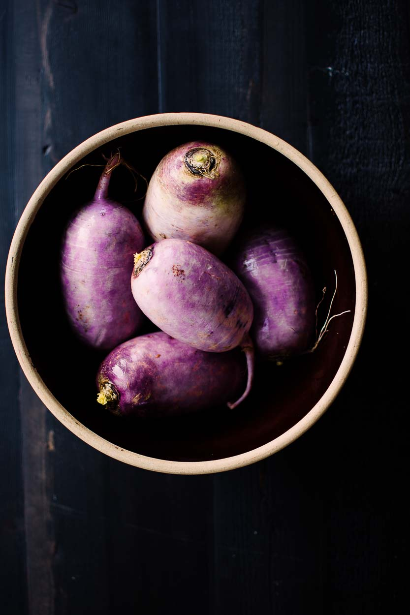 Purple Daikon Radishes in a bowl ready for Daikon Radish Kimchi