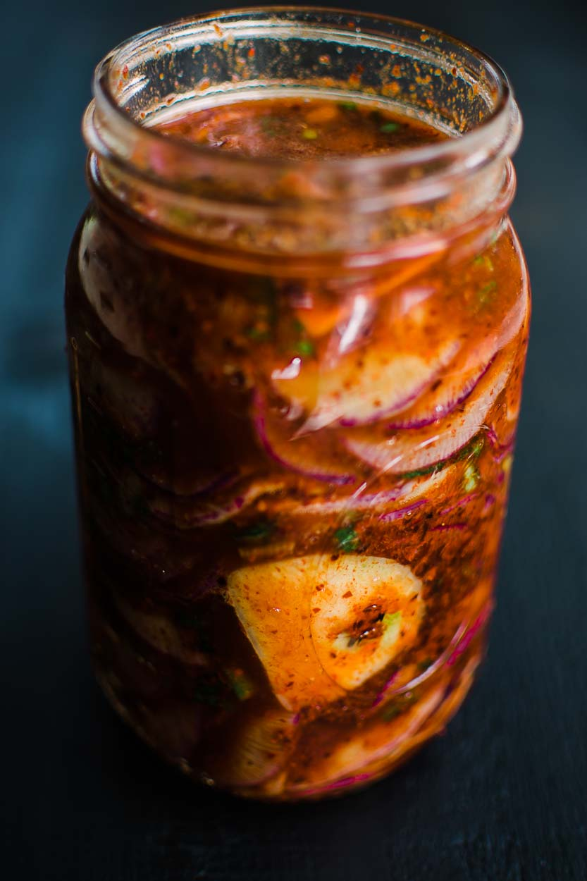 Radish Kimchi made with Daikon Radish, Ginger, Scallions, Garlic and Gochugaru ready to ferment.