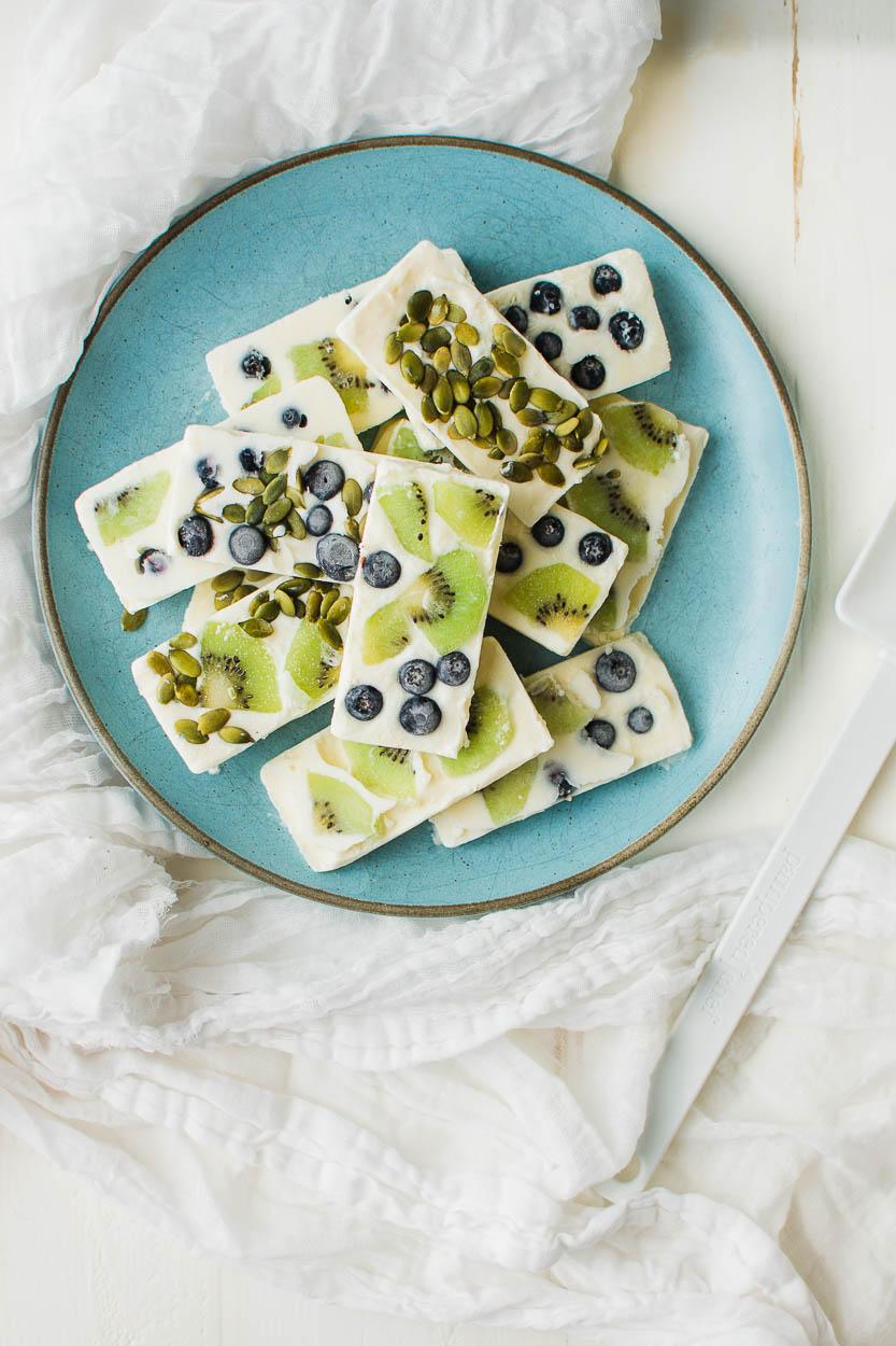 Frozen Yogurt Bars with kiwi, blueberries and pepitas.