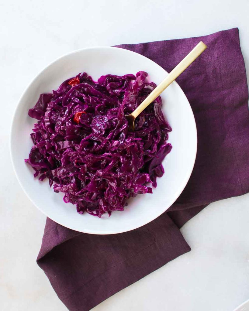 This Jalapeño Sauerkraut is made with red cabbage to give it a brilliant hot pink color.
