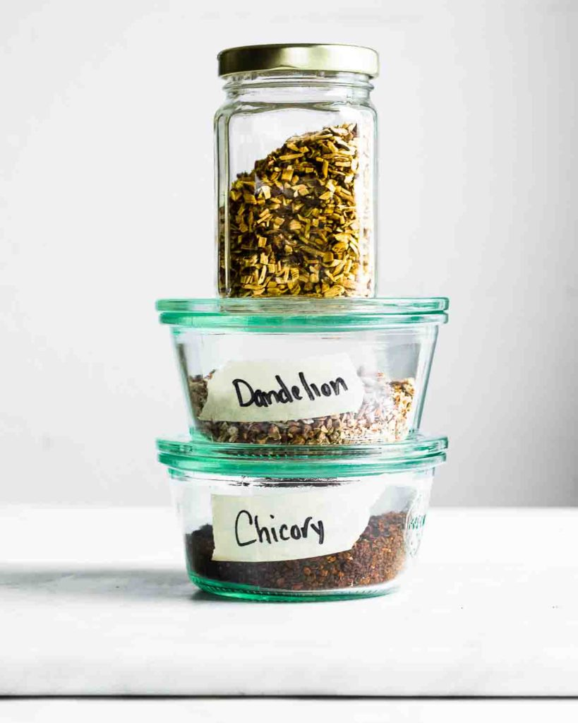 Ingredients for dandelion mocha (licorice, dandelion and chicory) in jars.