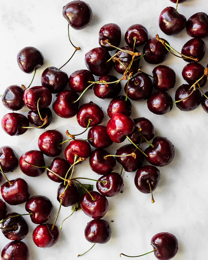 Northwest sweet cherries on a marble surface/