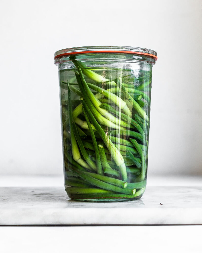 Garlic scapes in a glass jar